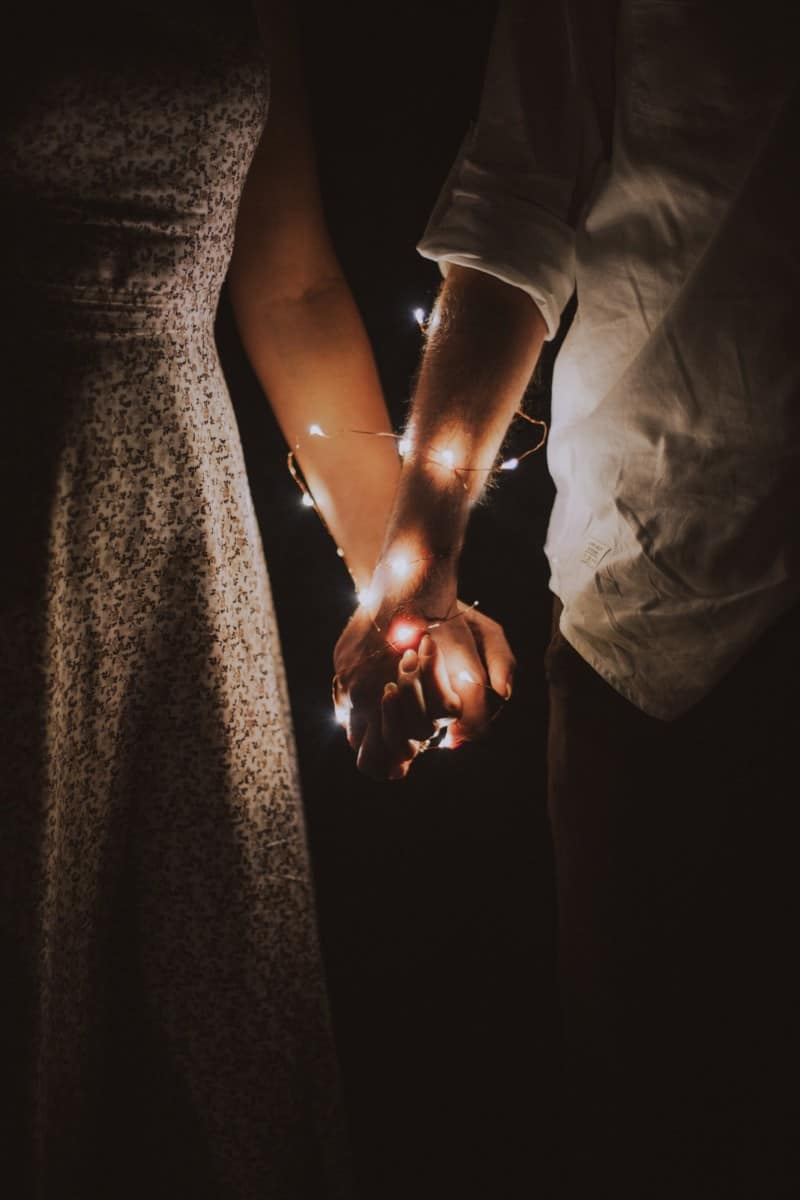 holding hands with lights